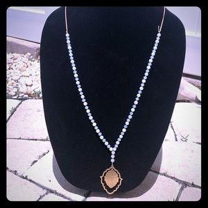 Pale blue bead with gold medallion necklace